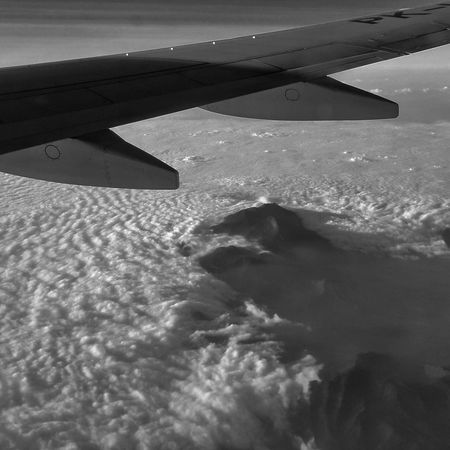 Sky and mountain From An Airplane Window Clouds And Sky Travelling Bw_collection