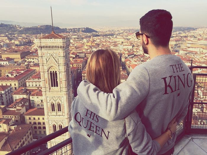 Rear View Of Couple Looking At Giotto Campanile From Observation Point In City