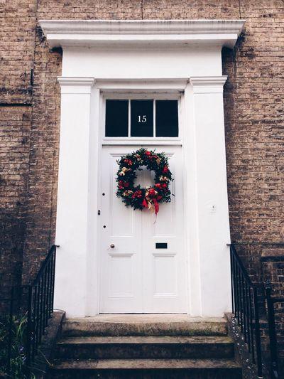Flower wreath on white door
