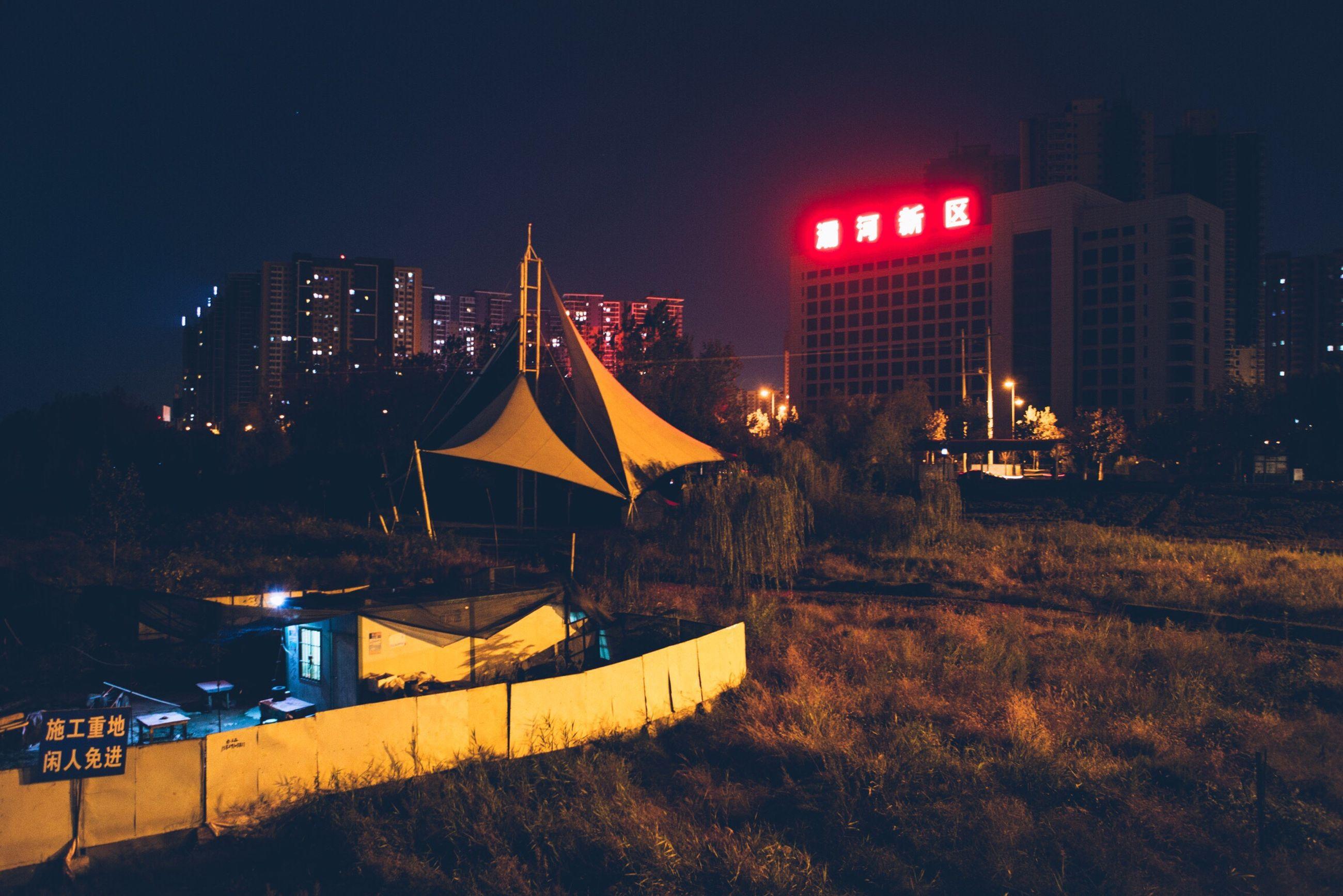 illuminated, night, building exterior, architecture, built structure, city, sky, city life, skyscraper, tower, tall - high, dark, growth, outdoors, neon, office building, modern, development, urban skyline
