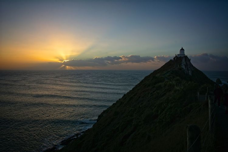 NZ South Island Nugget Point Lighthouse Beauty In Nature Cloud - Sky Horizon Horizon Over Water No People Orange Color Scenics - Nature Sea Sky Sunrise