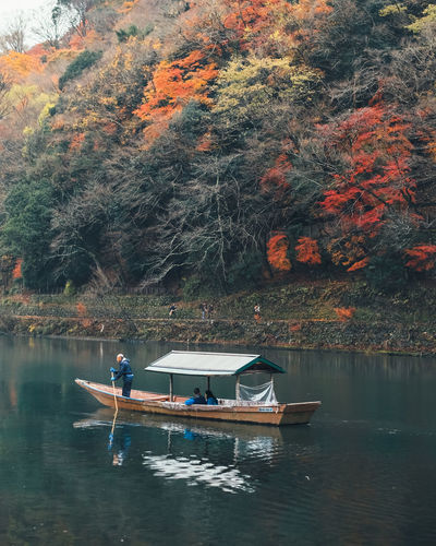 Slow but sure Water Nautical Vessel Transportation Mode Of Transportation Lake Tree Plant Waterfront Real People Men Nature Day Beauty In Nature Lifestyles Autumn Reflection People Two People Outdoors Rowing Change Rowboat It's About The Journey