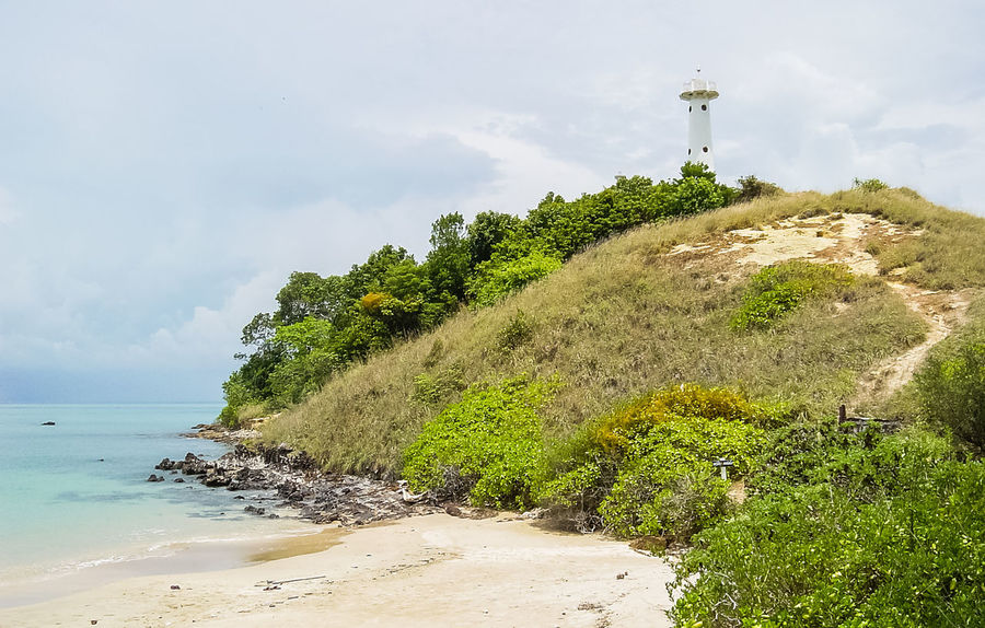 Beach Sea Cloud - Sky Nature Sand Sky Tree Outdoors Beauty In Nature Day Scenics Tranquility No People Water Landscape Horizon Over Water Lighthouse Lanta Yai Island Lanta Nationalpark Vacations Grass Island Travel Destinations Koh Lanta Krabi Thailand