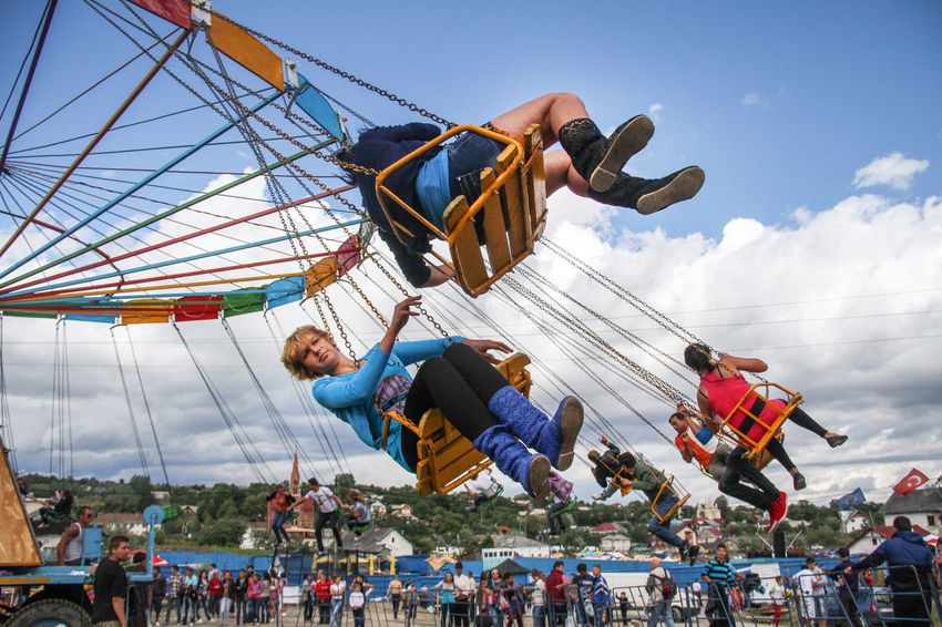 Fun Amusement Park Amusement Park Ride Arts Culture And Entertainment Carusell Country Fun Day Enjoyment Fun Large Group Of People Leisure Activity Lifestyles Low Angle View Men Outdoors People Real People Reportage Sitting Sky Women