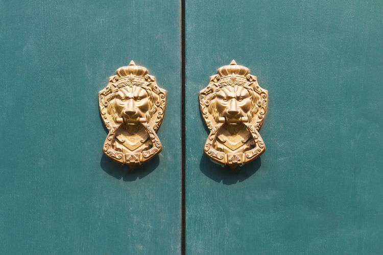 Close-up of knockers on door