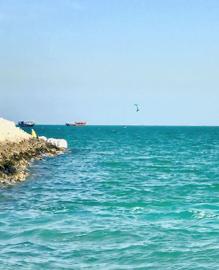 Sea Water Blue Nature Beauty In Nature Horizon Over Water Scenics Tranquility Outdoors Sky Tranquil Scene Day Beach Clear Sky No People Parachute Parasailing Dhaw EyeEmNewHere Doha Qatar Arabian Gulf Adapted To The City Blue Sky Travel Destinations