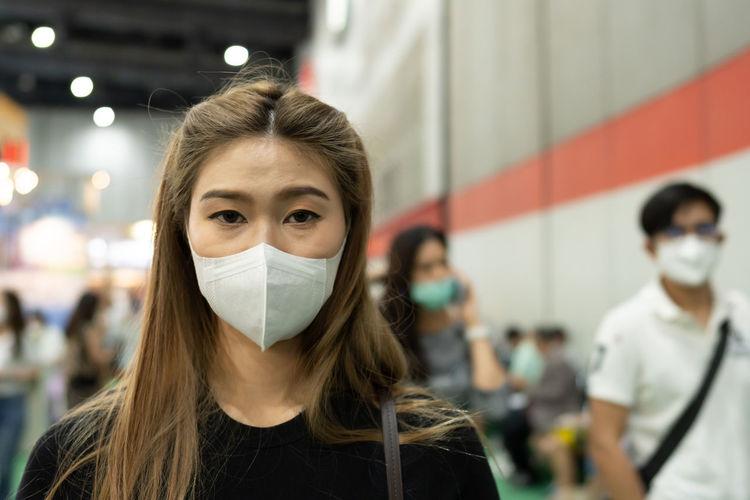 Portrait of woman wearing mask
