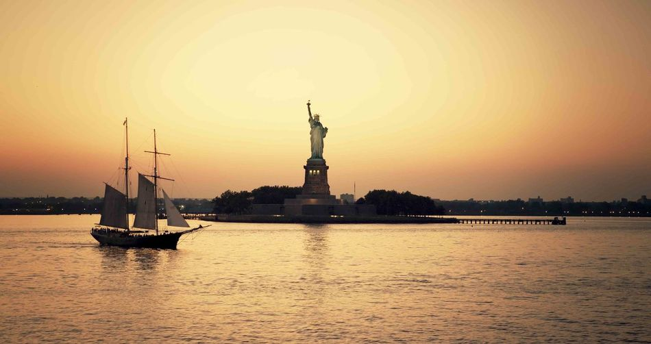 New York / the Statue of Liberty Statue Water Travel Destinations Sunset Silhouette Travel Nautical Vessel Outdoors Sky City Night Sculpture Sea Architecture No People Urban Skyline Cityscape Nature Vacations Sunlight Statue Of Liberty Vessel Cruise Ship