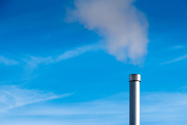Air Pollution Blue Chimney Cloud - Sky Day Emitting Environmental Issues Factory Fumes Industry Low Angle View No People Outdoors Pollution Sky Smoke - Physical Structure Smoke Stack Colour Your Horizn
