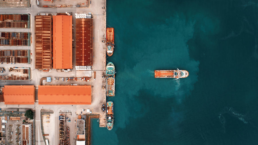 High angle view of commercial dock against sea