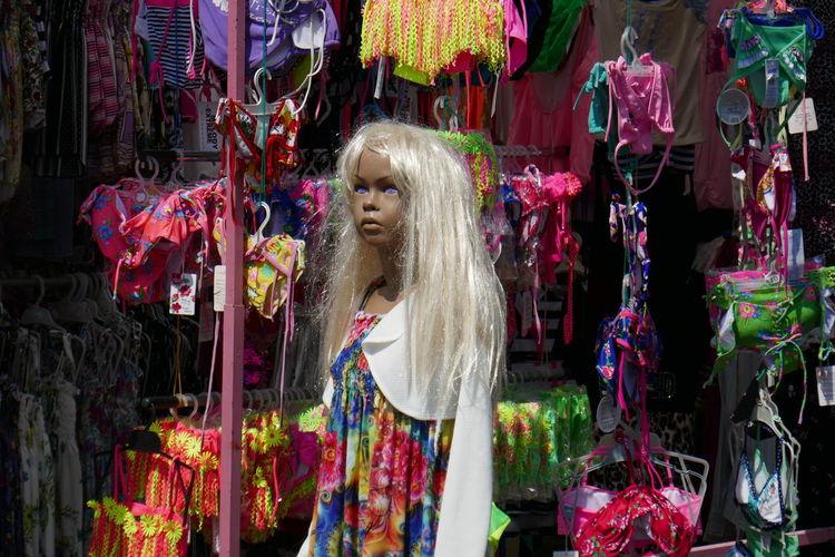 Doll hanging at market stall