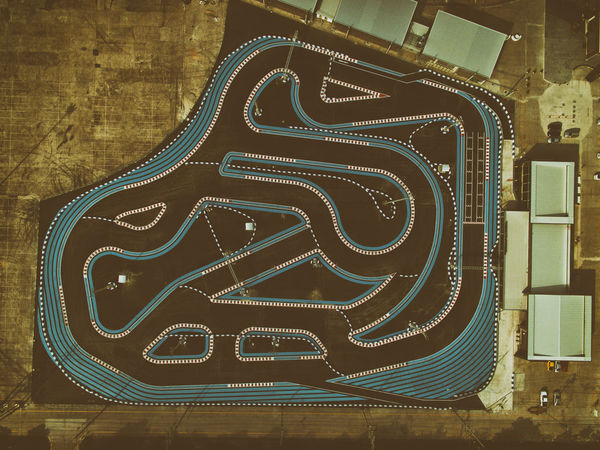 View from above of go kart racing track by drone Drone  Above View From Above Race Race Track Go Kart Go Karting Speed Fast Driver Adrenaline Curves Fresh On Eyeem  The Week On Eyem Geometric Shape Below Looking Down Looking Below Looking Down From Above Looking From Above Pattern Track Flying High
