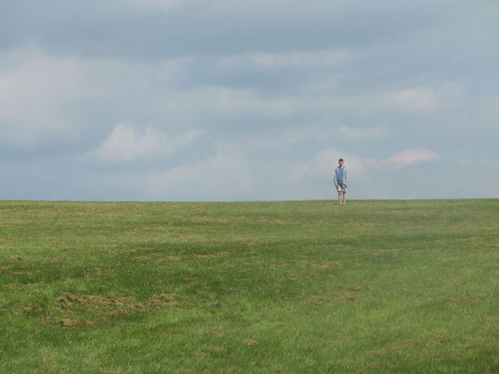 Lost In The Landscape Adult Beauty In Nature Day Field Full Length Grass Landscape Leisure Activity Lifestyles Men Nature One Person Outdoors People Real People Rear View Scenics Sky Standing Walking Women