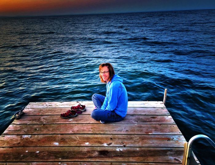 Madelineisland Wisconsin Sunrise Lakesuperior Greatlakes Water One Person Sitting Sea Leisure Activity Real People Nature Scenics - Nature Beauty In Nature Relaxation Tranquility Outdoors