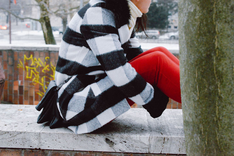 Adults Only City Cold Cold Temperature Colors Day Fashion Intimacy Loneliness One Person One Woman Only Outdoors Portrait Snow Squares Thinking Warm Clothing Winter Winter