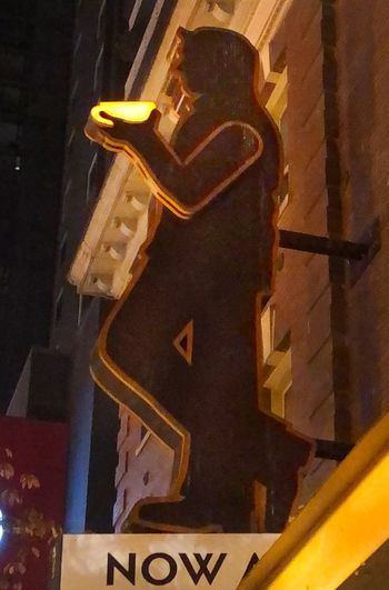 Low angle view of text on building at night