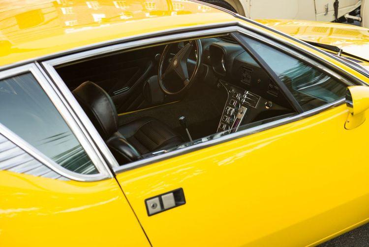 High angle view of yellow car on window