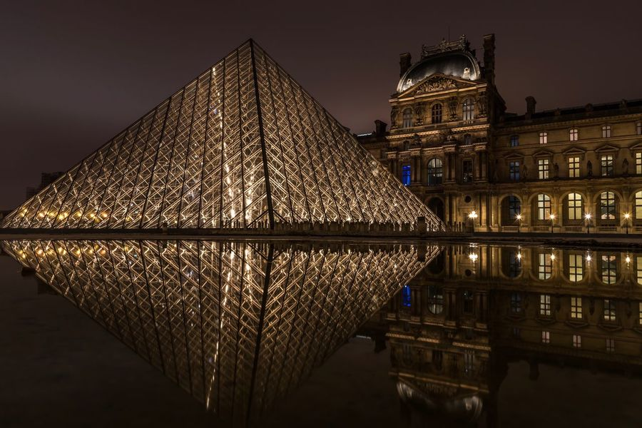 Reflection of the Louvre Pyramid, the main entrance to the Louvre Museum in Paris after dark. Architecture Travel Destinations Pyramid City Lights Paris, France  Cityscape Paris Musée Du Louvre LourveMuseum Reflection