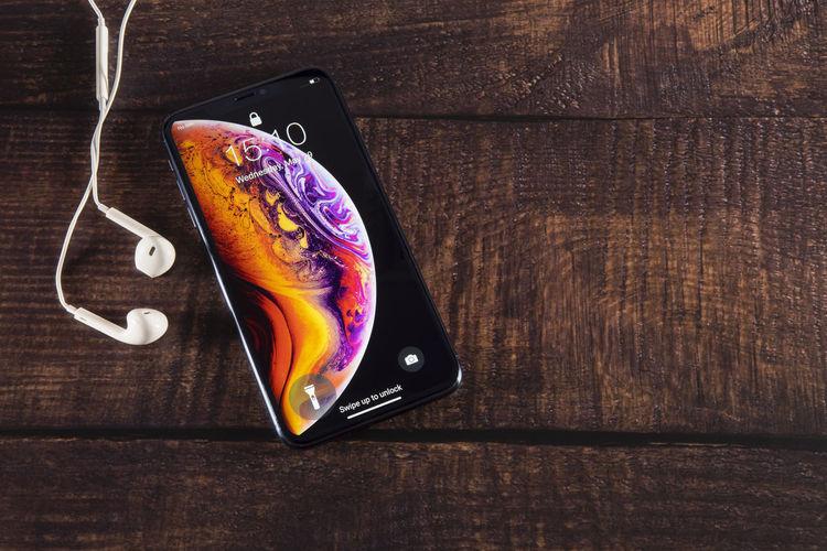 High angle view of broken smart phone on table