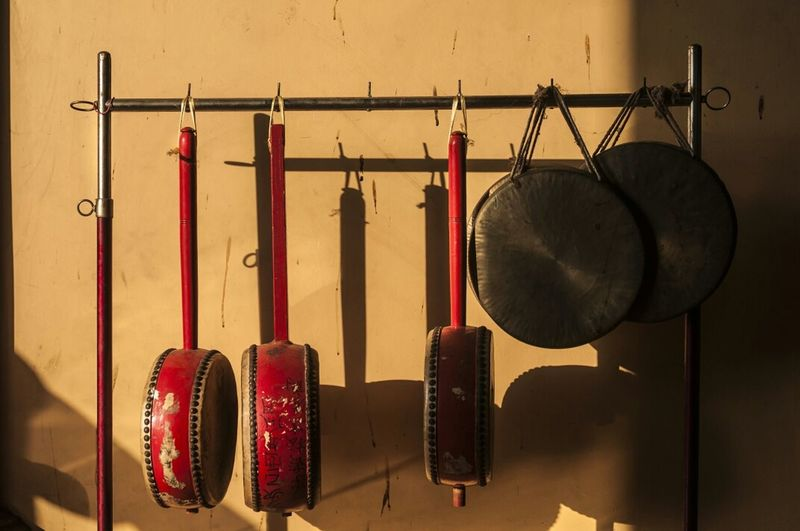 Close-Up Of Pans Hung On Hooks