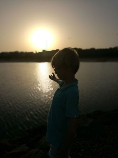 Water Child Childhood Sunset Lake Boys Standing Fishing Reflection Discovery Calm Shore Explorer Ocean Sandy Beach Outline Mid Distance Standing Water