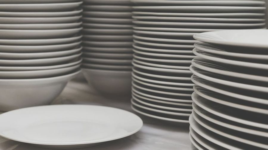 Stack Of Bowls And Plates On Table