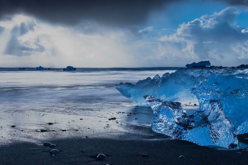 Rising lights and shimmering ice on a intense morning in southern Iceland. Stop Global Warming Glacier Lagoon Iceland Sea Sky Cloud - Sky Water Scenics - Nature Land Beauty In Nature Horizon Over Water No People Tranquility Beach Outdoors