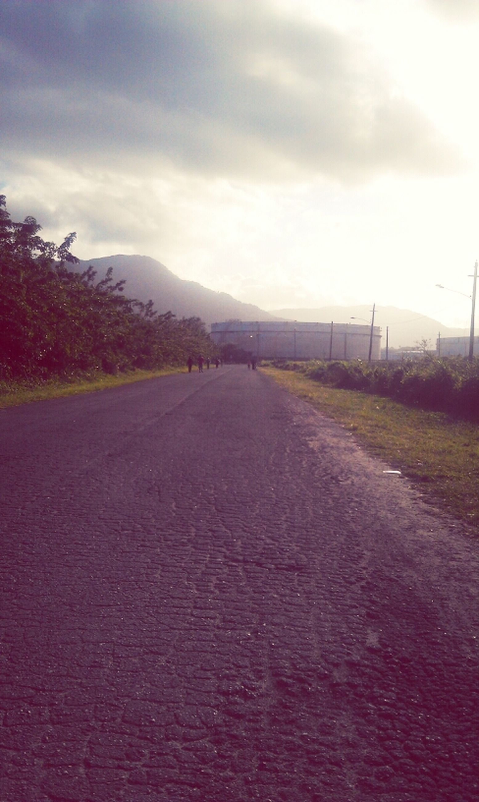 the way forward, sky, cloud - sky, cloudy, road, diminishing perspective, vanishing point, tranquil scene, tranquility, cloud, transportation, landscape, empty, country road, mountain, overcast, nature, scenics, weather, beauty in nature