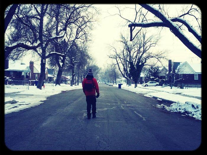 outside. walking to school.
