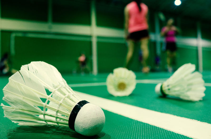 badminton Sport Focus On Foreground Close-up Incidental People Ball Leisure Activity Soccer Team Sport Competition Sports Equipment Real People Leisure Games Selective Focus Playing Day Indoors  People Green Color Net - Sports Equipment Shoe Badminton Shuttlecock