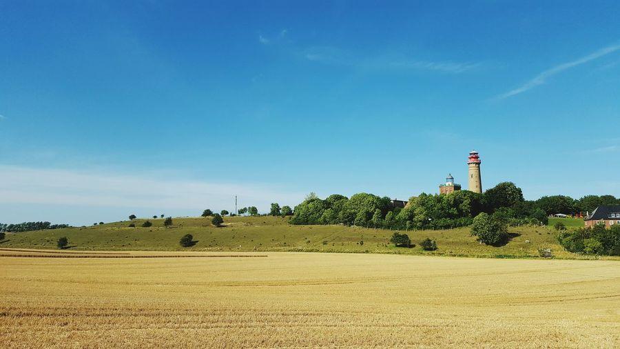 Countryside Landscape Against Blue Sky