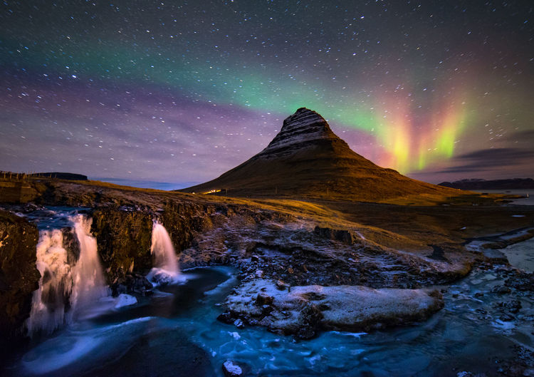 northern light dance Astronomy Aurora Polaris Beauty In Nature Cold Temperature Dramatic Sky Galaxy Ice Kirkjufell Landscape Mountain Natural Phenomenon Nature Night No People Outdoors Scenics Sky Snow Star - Space Tranquil Scene Tranquility Water Waterfall Winter