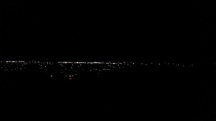 Night flight Copy Space Dark Illuminated City No People Outdoors Nature