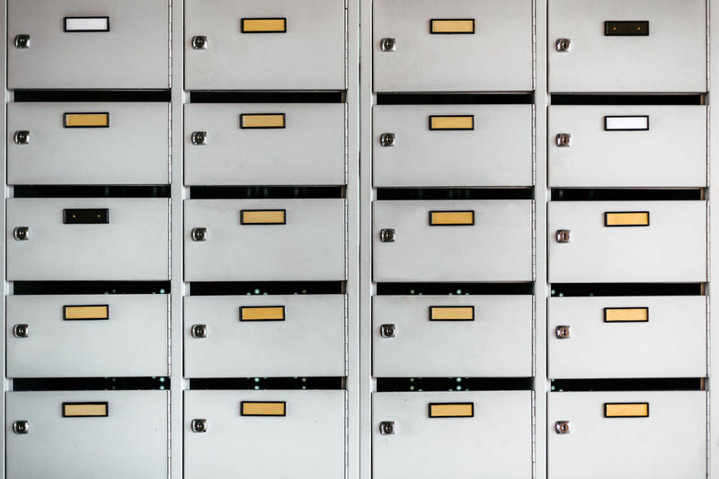 row of post office boxes Full Frame Repetition No People Backgrounds In A Row Safety Security Indoors  Pattern Locker Side By Side Protection Architecture Built Structure Metal Closed Order Building Storage Compartment White Post Office Boxes Letter Letterbox Letters