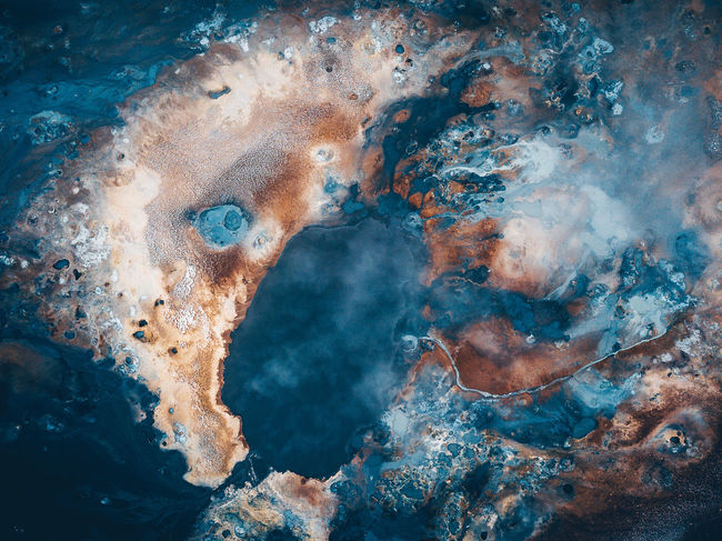 Abstractions of nature. Iceland, Hverir geothermal spot noted for its bubbling pools of mud & steaming fumaroles emitting sulfuric gas. Aerial Shot Colors DJI Mavic Pro DJI X Eyeem Geothermal Fields Hot Myvatn Nature Abstract Abstractions Art Of Nature Beauty In Nature Blue Digital Composite Hverir Iceland_collection Mavic Pro Mud Nature Outdoors Pattern Pool Shapes And Forms Top Down View Water