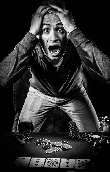 Poker player. Gambling concept Blackjack Casino Gambling Jackpot Man Poker Addiction Black And White Entertainment Gambler Gambling Chip Game Indoors  Male Men Night One Man Only Player Playing Card Games Poker - Card Game Poker Chips Poker Game Studio Shot Table Young Adult