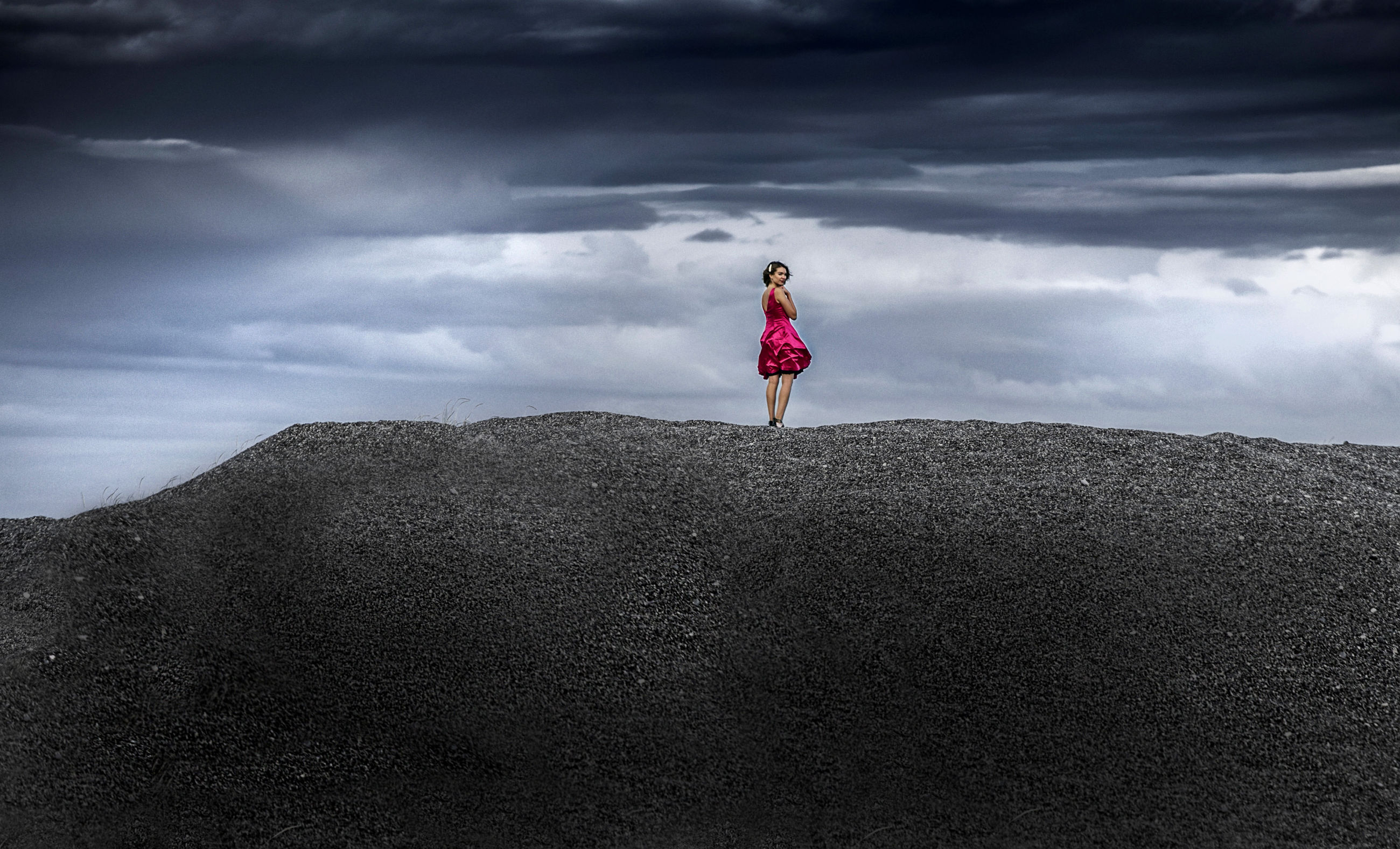 cloud, one person, sky, horizon, full length, adult, nature, sea, environment, land, landscape, standing, women, mountain, beauty in nature, leisure activity, sand, sports, overcast, lifestyles, outdoors, dramatic sky, storm, young adult, solitude, darkness, day, scenics - nature, rear view, storm cloud, exercising, cloudscape, activity, clothing, rock