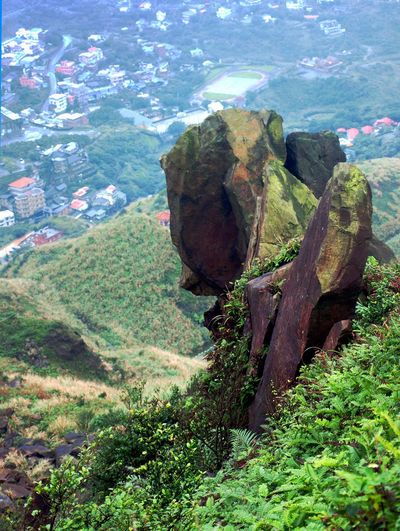 A precariously balanced group of rocks next to a hiking trail above the town of Jinguashi, Taiwan. Jinguashi Jiufen, Taiwan Precarious Ruifang District Balance Beauty In Nature Day Green Color Growth Landscape Mountain Nature No People Outdoors Physical Geography Rock - Object Scenics