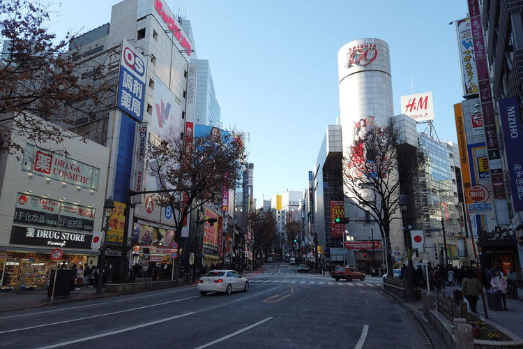 Urban Winter Street City Shibuya Tokyo Japan Architecture Building Exterior Built Structure Transportation Motor Vehicle Car Mode Of Transportation Road Building Sky Land Vehicle Office Building Exterior City Street Day Text Sign Skyscraper Outdoors