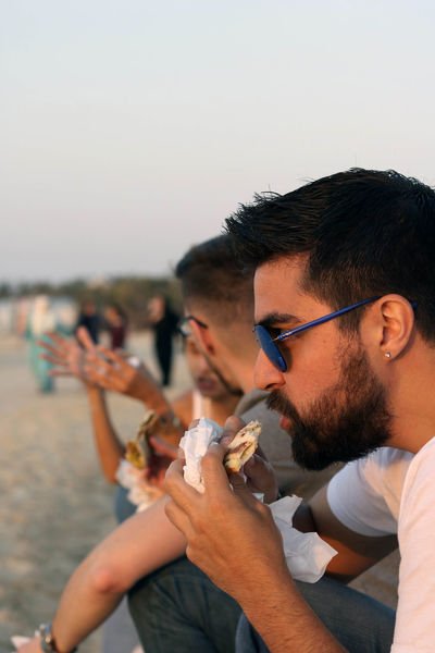 Adult Close-up Day Eating Friendship Fun Lifestyles Manakish Outdoors People Portrait Social Gathering Sunset Togetherness Young Adult