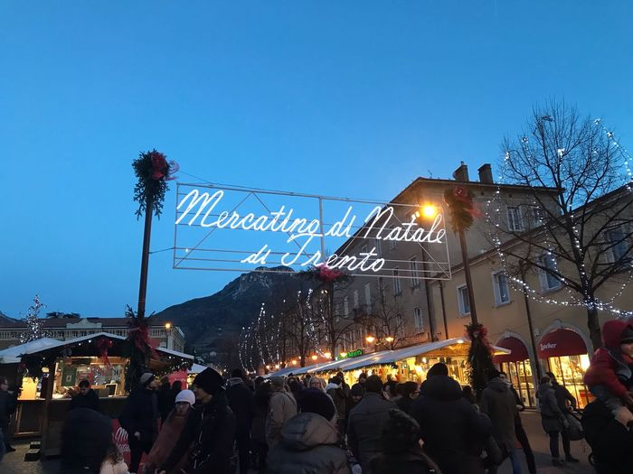 Mercatino Di Natale Christmas Lights Illuminated Sky Text City Nature Large Group Of People First Eyeem Photo
