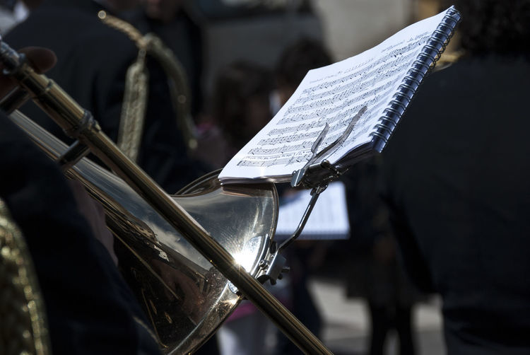Arts Culture And Entertainment Bicycle Brass Instrument  City Close-up Day Focus On Foreground Incidental People Metal Music Musical Equipment Musical Instrument Outdoors Paper Sheet Sheet Music Silver Colored Street Trumpet Wind Instrument