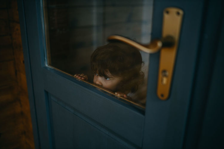 Cute girl peeking through window