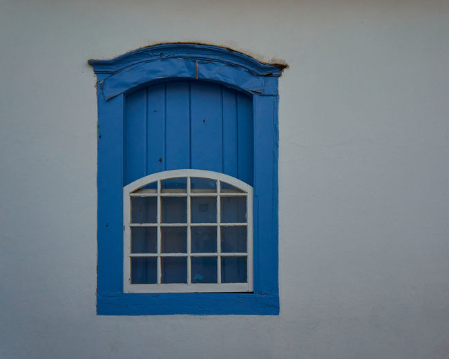 Low angle view of blue house window on building