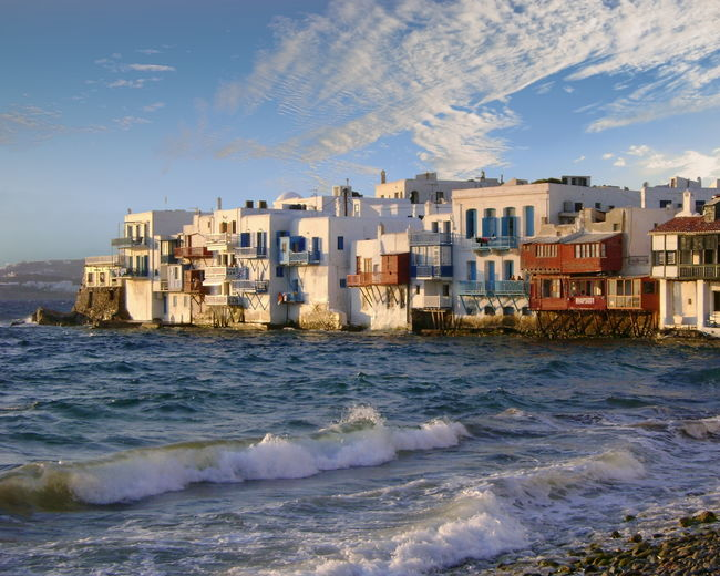View of Little Venice on the island of Mykonos, Greece Architecture Beauty In Nature Building Exterior Built Structure City Day Greece House Little Venice Mykonos Motion Mykonos Nature No People Outdoors Power In Nature Residential Building Sea Sky Urban Skyline Water Waterfront Wave