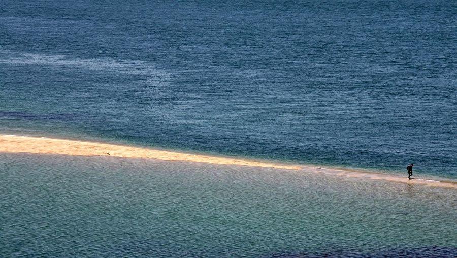 High angle view of man walking at beach
