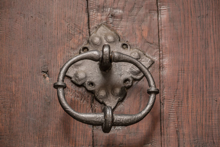 Old door of a historical building with iron door knob Door Knocker Wood - Material Door Entrance Metal Close-up No People Animal Animal Themes Brown Safety Mammal Old Protection Shape Security Animal Wildlife Design One Animal Indoors  Animal Head  Wood Grain
