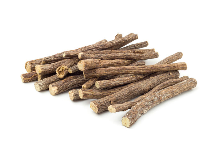 Liqorice roots on white background Aromatic Ayurveda Bio Biological Black Candy Cold Diet Food Health Healthy Heap Herb Herbal Ingredient Isolated Licorice Liquorice Medicinal Medicine Natural Nature Organic Pile Plant