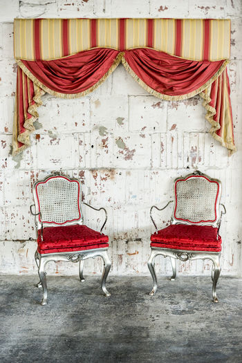Chairs against wall