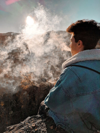 Abandoned Cliff Forest Vape Smoke person RISK Danger Men Sunset Sunlight Standing Sky Casual Clothing Sun Shining Calm EyeEmNewHere